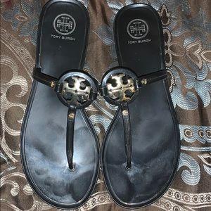 Tory Burch black letter sandals.